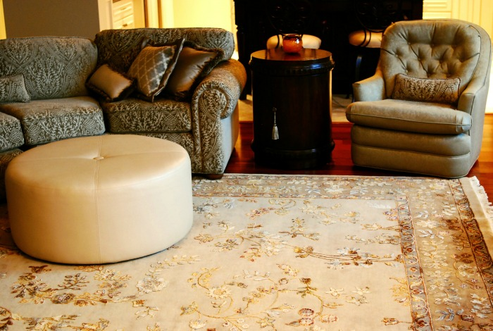A round ottoman is soft on the feet and makes great use of the space in front of a sectional and allows for extra seating